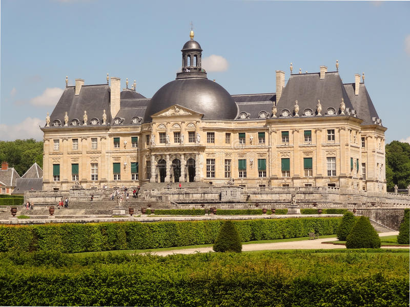 Vaux-le-Vicomte. The Château de Vaux-le-Vicomte is a baroque French château located in Maincy, near Melun, 55 kilometres (34 mi) southeast of Paris in the royalty free stock image