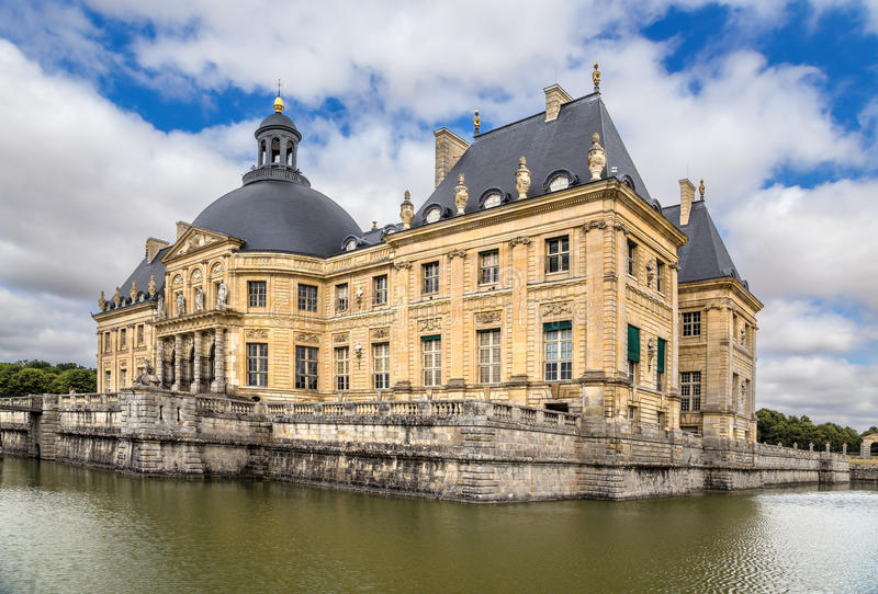Vaux-le-Vicomte, France. View of the central building of the estate, surrounded by an artificial channel. Vaux-le-Vicomte - classic French manor-palace of of the stock photo
