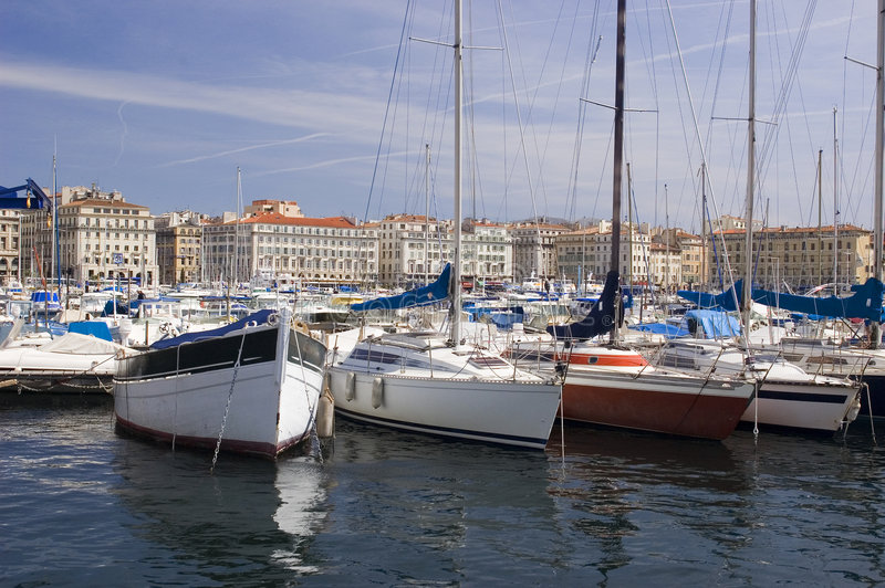 Vaux Port boats. Boats in the Vaux Port in Marseille France against a dramatic blue sky and cityscape stock photo