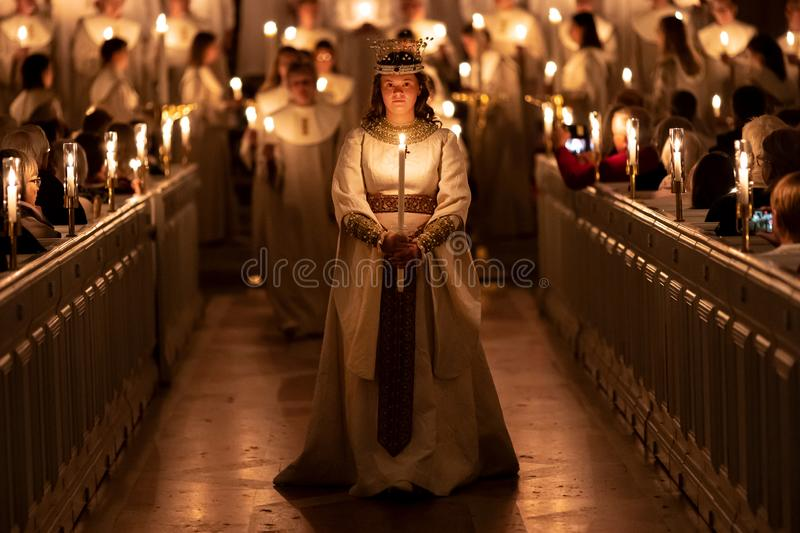 Vaxjo, Sweden - December, 2019. Saint Lucia Day choir celebrates the coming of Christmas. In the church stock photo