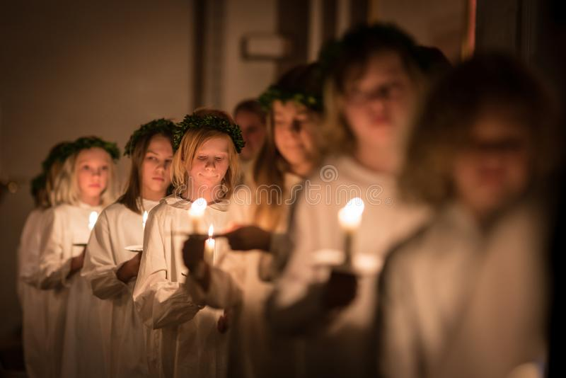 Vaxjo, Sweden - December, 2017: The swedish tradition of Lucia is celebrated in Vaxjo church with song, candles and white gowns stock images