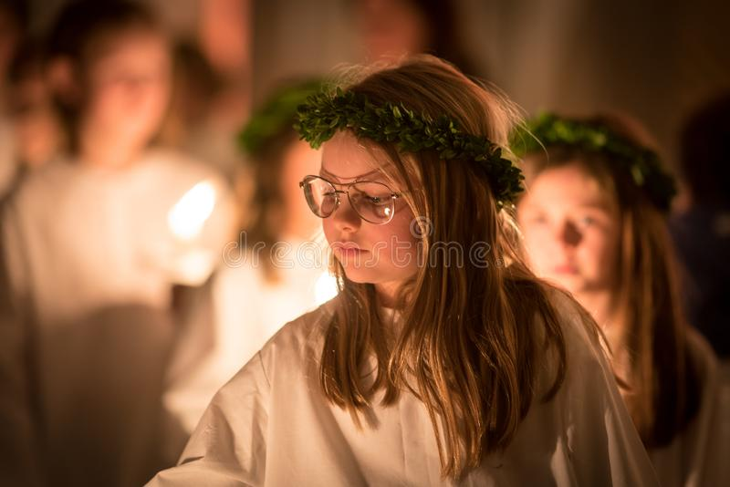 Vaxjo, Sweden - December, 2017: The swedish tradition of Lucia is celebrated in Vaxjo church with song, candles and white gowns stock photo