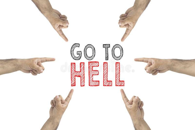 Vaya al concepto del infierno Manos alrededor de mostrar a la inscripción: vaya al infierno imágenes de archivo libres de regalías