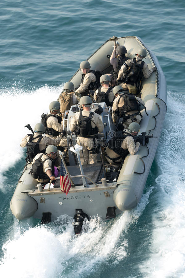 VBSS boat riders. Members of the Navy`s Visit Board Search and Seizure team prepare to board a vessel in the Persian Gulf royalty free stock photos