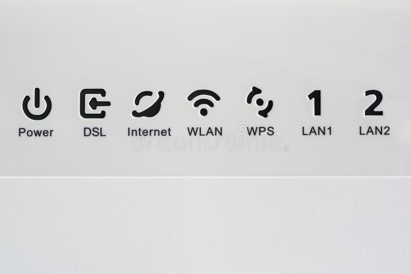 VDSL modem, combined device for modulation and demodulation. Network icons: DSL, internet, WLAN, WPS, LAN and power. VDSL modem, combined device for modulation stock images