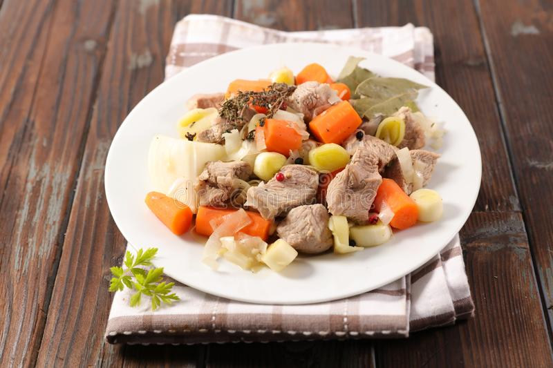Veal, carrot and leek. On wood royalty free stock images