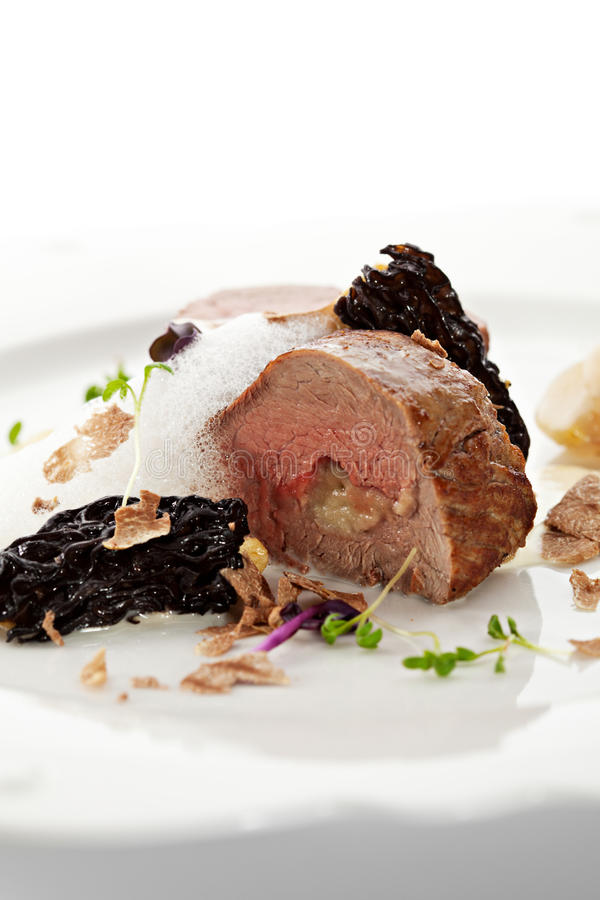 Veal Fillet Mignon. Stuffed with Artichoke royalty free stock photography