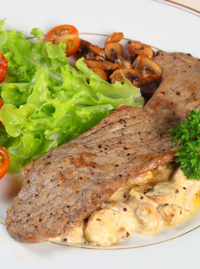 Veal with mushrooms in cream sauce vertical royalty free stock photos