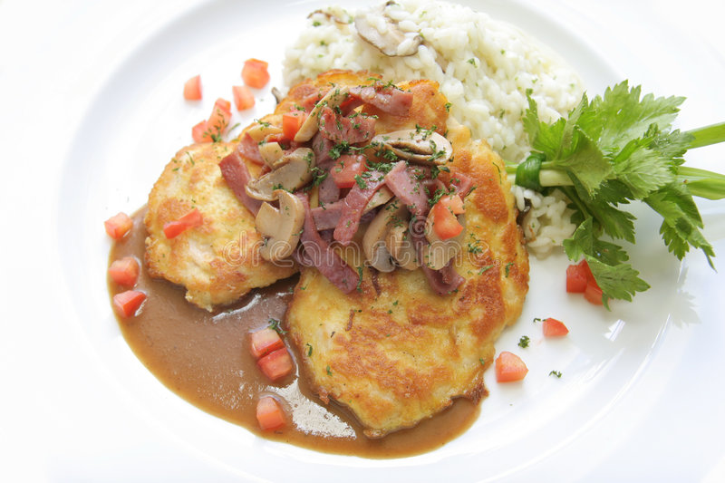 Veal Piccata With Risotto Rice Stock Photo