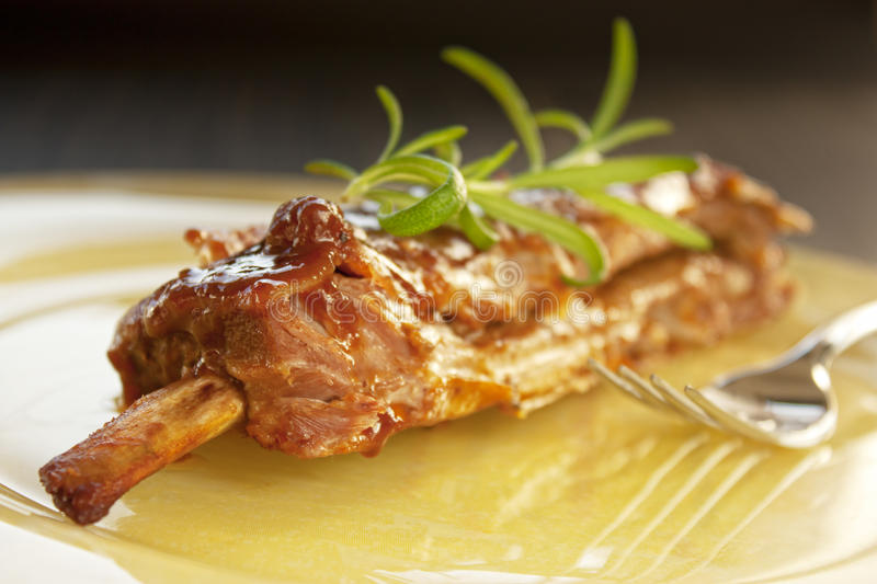 Veal ribs with sauce stock photos
