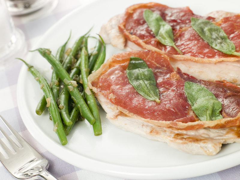 Veal Saltimbocca with Green Beans stock photography