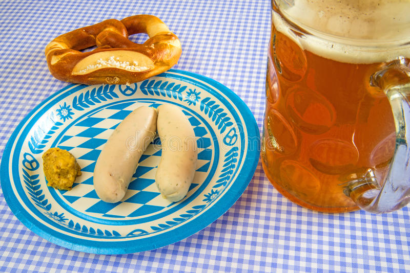 Veal sausage dish on Oktoberfest. Veal sausage dish with beer mug on Oktoberfest royalty free stock images