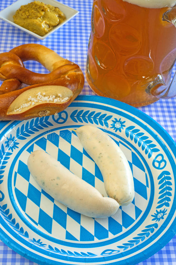 Veal sausage dish on Oktoberfest. Veal sausage dish with beer mug on Oktoberfest royalty free stock image