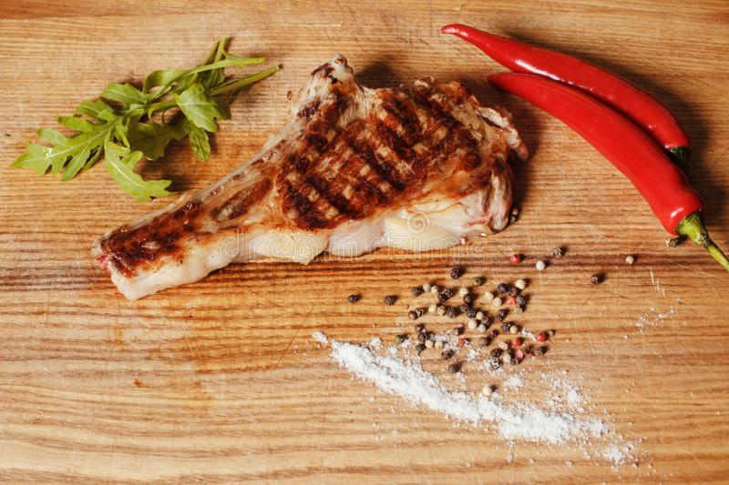 Veal steak on the bone royalty free stock images