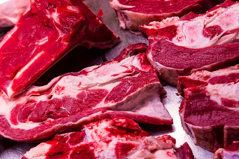 Veal steak raw bright red sliced piece flat large portion bone part cutting tray farm market royalty free stock photos