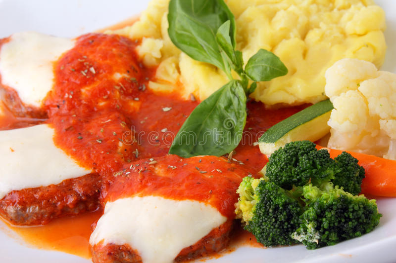 Download Veal With Tomato And Garnish Close Up Stock Photo - Image: 24358126