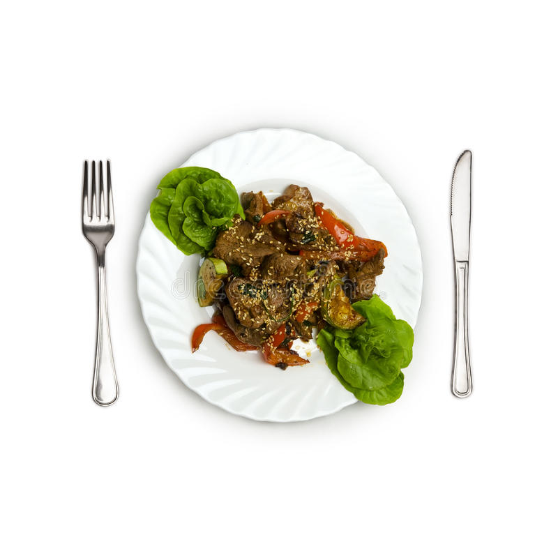 Veal with Vegetables and Piquant Sauce. Veal with vegetables. juicy slices of veal with grilled vegetables under a spicy sauce, sesame emphasizes a symphony of royalty free stock image