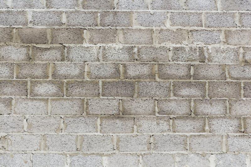 Vecchi fondo e struttura della parete del blocco in calcestruzzo fotografia stock libera da diritti