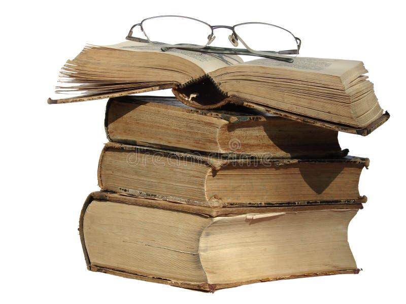 Vecchi libri e vetri fotografia stock libera da diritti