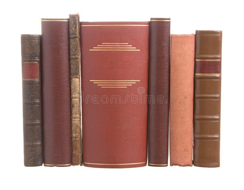 Vecchi libri rilegati di cuoio con un libro largo immagine stock libera da diritti