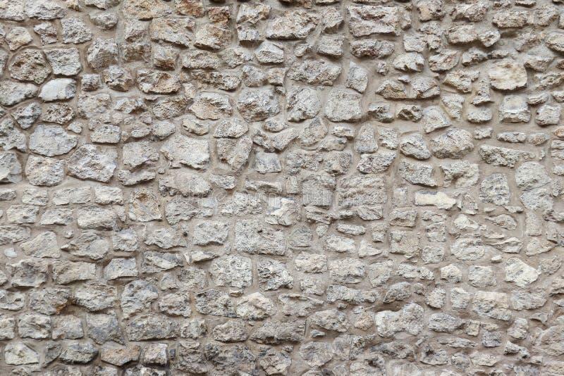 Vecchi parete di pietra e cemento Fondo di pietra Parete di pietra di Cracovia immagine stock libera da diritti