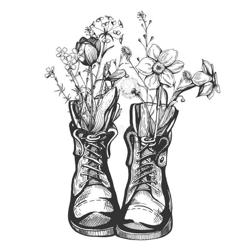 Vecchi stivali d'annata riempiti di fiori selvaggi illustrazione di stock