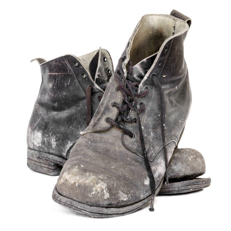 Vecchi stivali isolati immagini stock