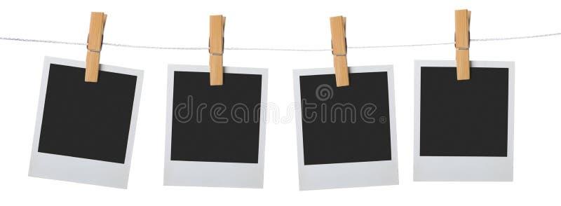Vecchia attaccatura del palaroid del blocco per grafici della foto da rope fotografie stock
