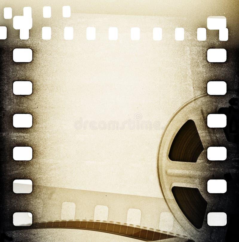 Vecchia bobina di film con la striscia di pellicola. Fondo d'annata royalty illustrazione gratis
