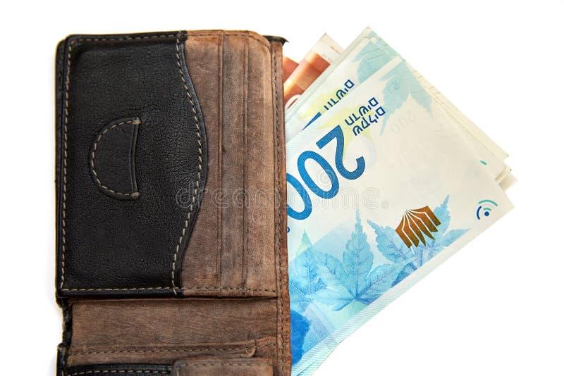 Vecchia, borsa misera con soldi, isolati su fondo bianco fotografia stock libera da diritti
