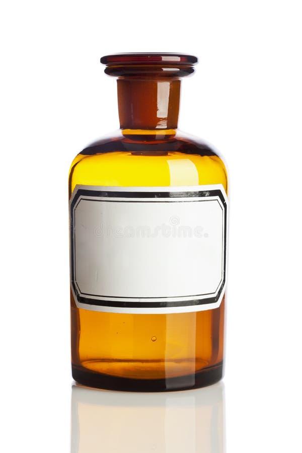 Vecchia bottiglia della farmacia, etichetta in bianco fotografia stock