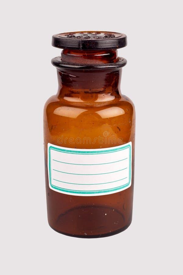 Vecchia bottiglia della medicina con l'etichetta in bianco fotografie stock