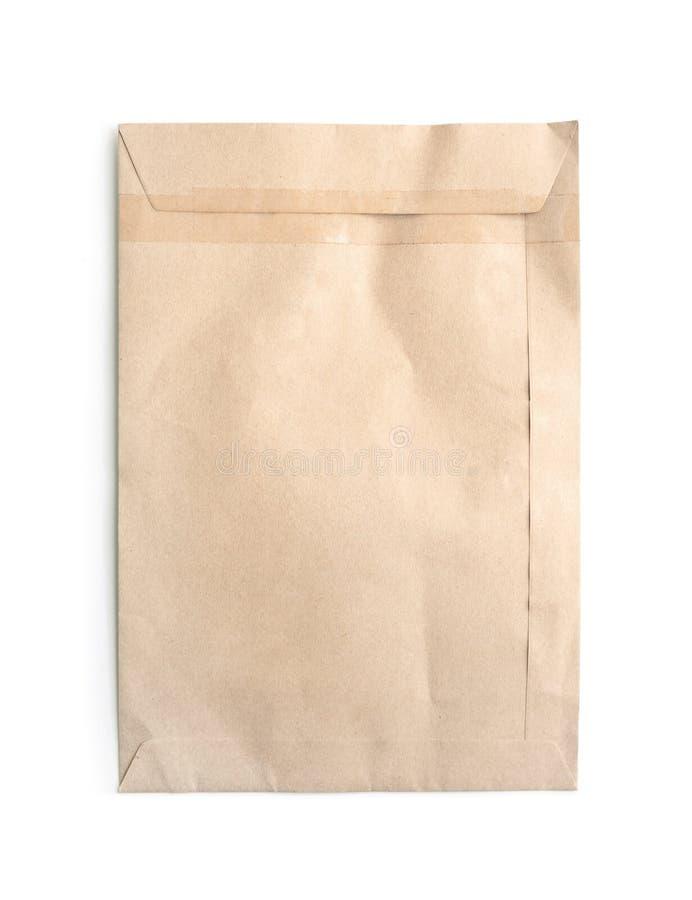 Vecchia busta di carta Pacchetto del documento di Brown isolato su bianco immagini stock