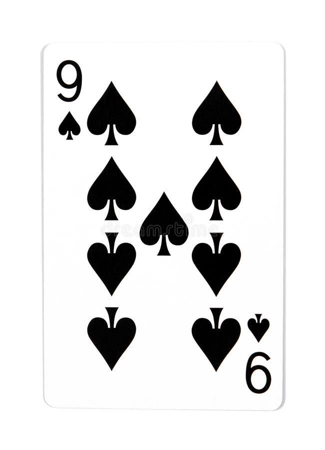 Vecchia carta da gioco nove isolata su un fondo bianco Carte da gioco isolate fotografia stock