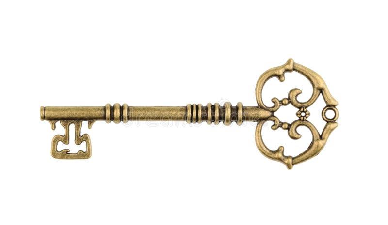 Vecchia chiave isolata su fondo bianco senza ombra fotografia stock libera da diritti
