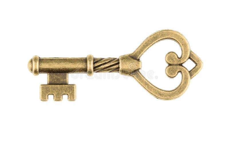 Vecchia chiave isolata su fondo bianco senza ombra immagine stock