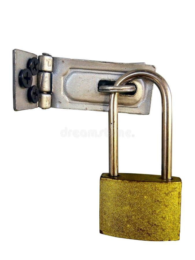 Vecchia chiave primaria dorata con le cerniere di alluminio fotografie stock libere da diritti