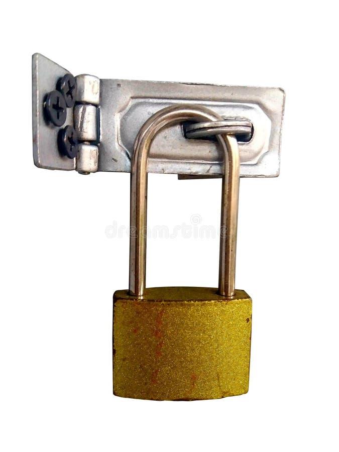 Vecchia chiave primaria dorata con le cerniere di alluminio fotografia stock