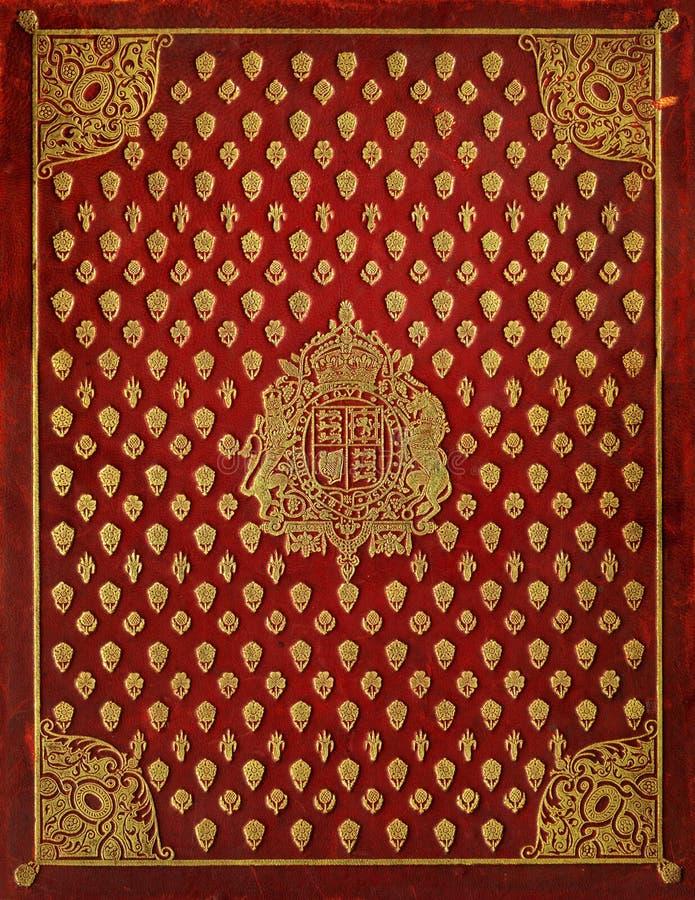 Vecchia copertina di libro di cuoio con i simboli reali royalty illustrazione gratis