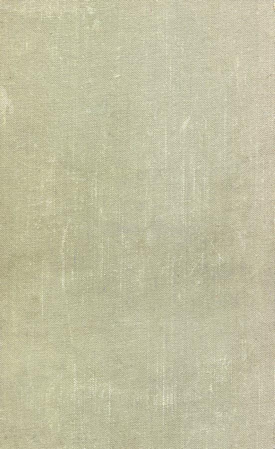 Vecchia copertina di libro verde chiaro sporca e graffiata del panno Fondo immagini stock libere da diritti