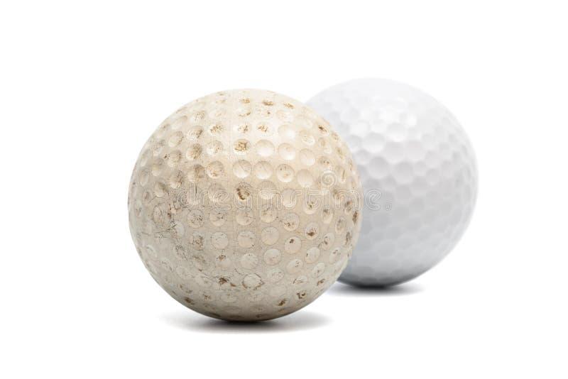 Vecchia e nuova sfera di golf immagine stock libera da diritti