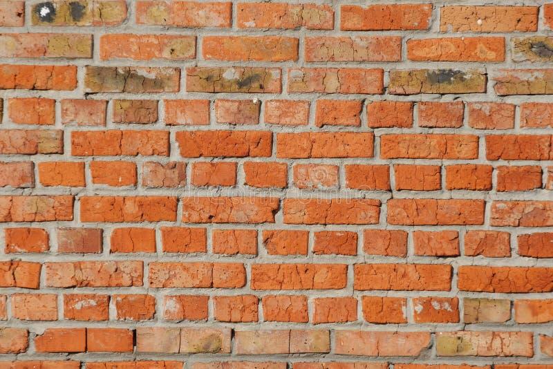 Vecchia fine rossa del muro di mattoni su immagini stock