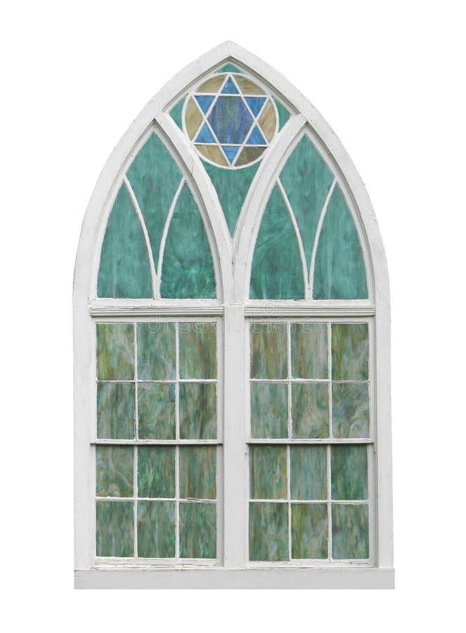 Vecchia finestra incurvata della chiesa isolata fotografie stock