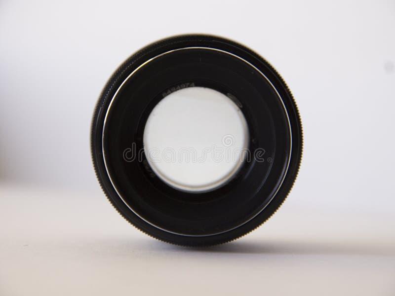 Vecchia lente su fondo bianco immagine stock