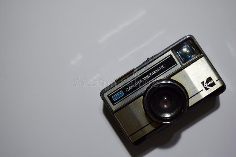 Vecchia macchina da presa Primo piano bianco del fondo Foto dell'annata fotografia stock libera da diritti