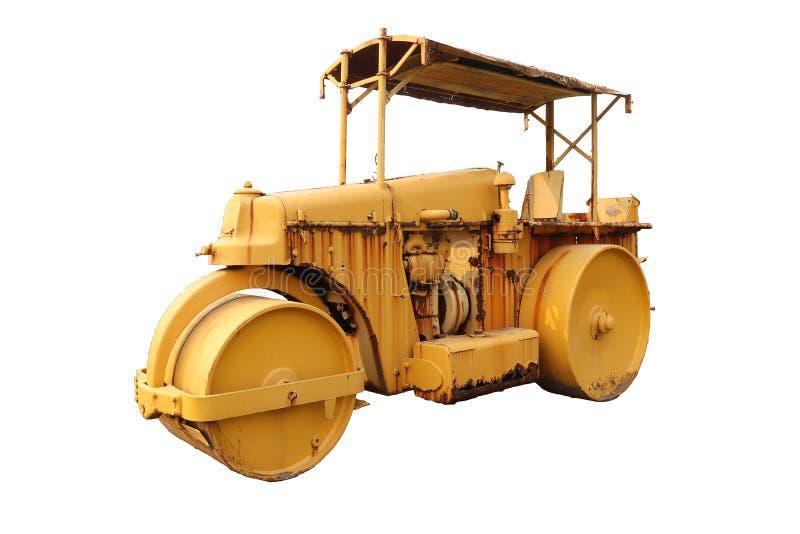 Vecchia macchina del compattatore del rullo con colore giallo Isolato su priorit? bassa bianca immagini stock