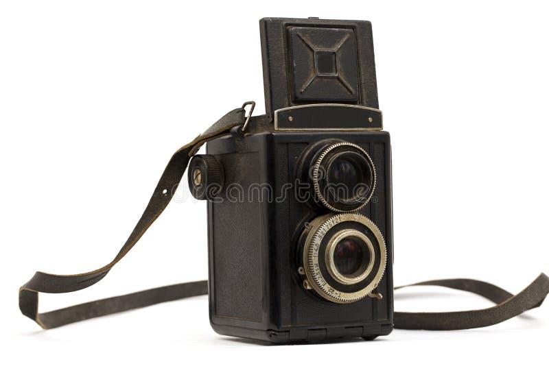 Vecchia macchina fotografica con una cinghia fotografia stock libera da diritti