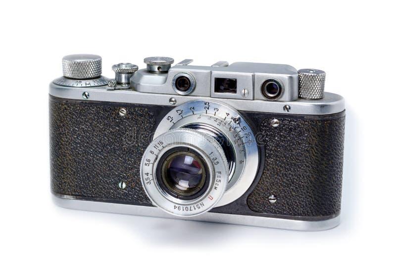 Vecchia macchina fotografica della foto del film dell'annata 35mm isolata su fondo bianco immagine stock