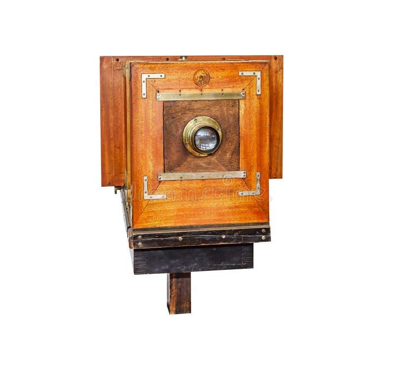 Vecchia macchina fotografica di legno d'annata della foto isolata su un bianco fotografie stock