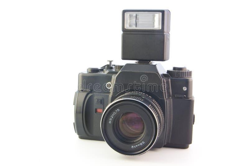 Vecchia macchina fotografica di SLR con il flash immagine stock